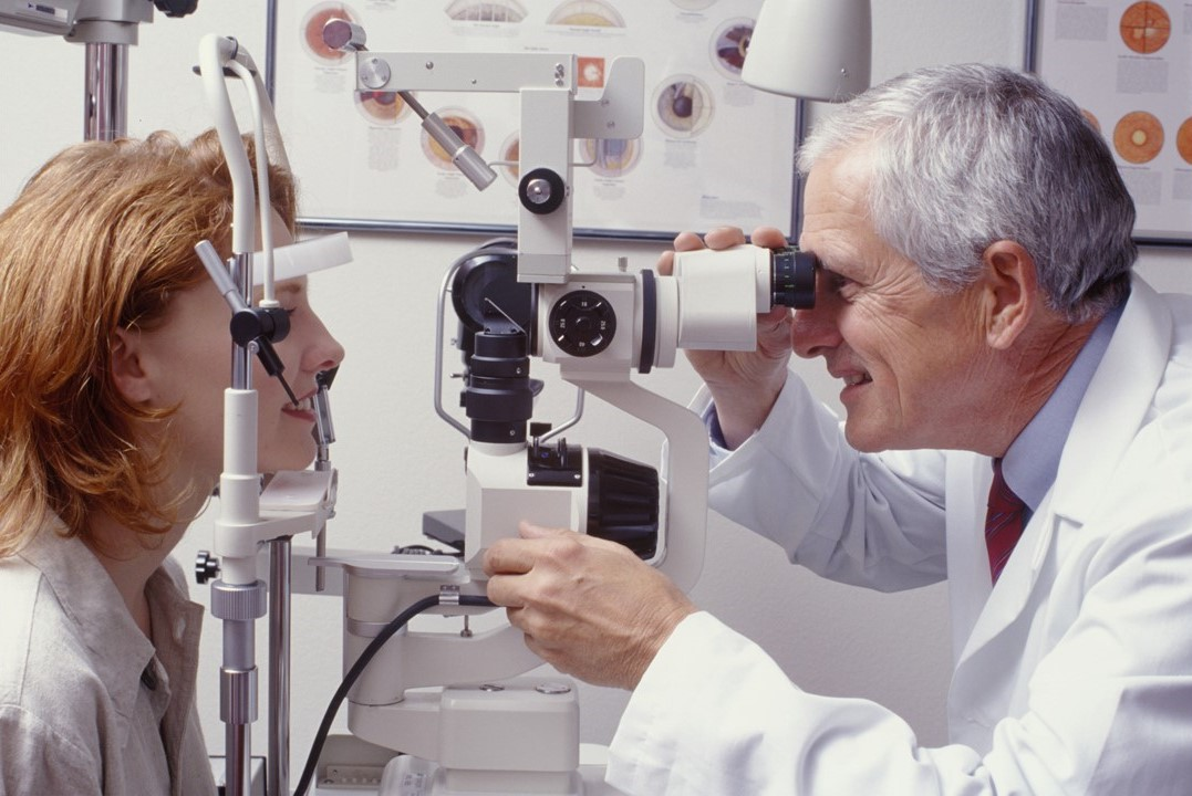 ophthalmologist with slit-lampexamining patient